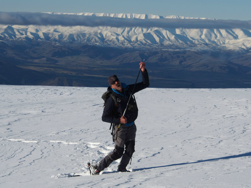Central Otago winter fun: a scenic helicoptyer flighht combined wth snow shoeing, dog sledding, cross country skiing and hot chocolates in the snow
